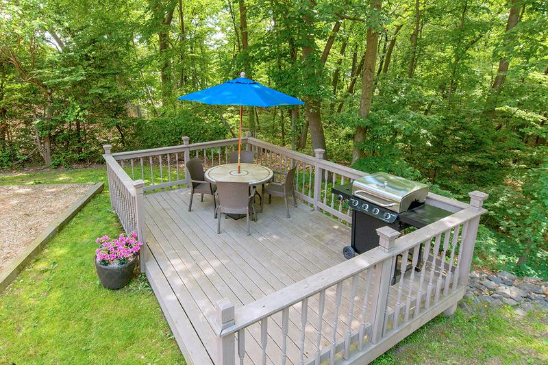 Picnic Deck | This deck that has a scenic view of the woods in back of our community is a great spot to relax or entertain! It directly overlooks the playground so adults have a place to sit while the little ones play!