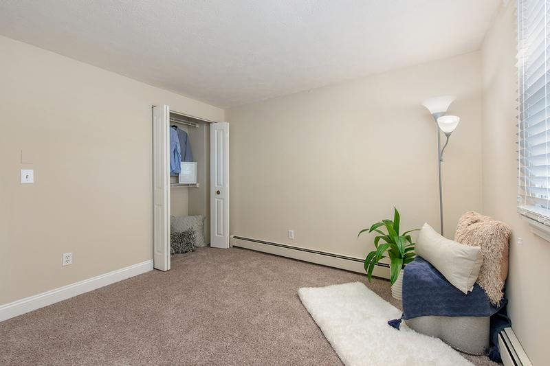 Bedroom | Spacious bedroom featuring plush carpeting and a large window.