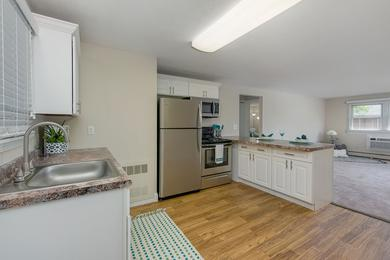 Second Floor 1 Bedroom Kitchen | Our second floor 1 bedroom floor plans has a different layout that features a breakfast bar.