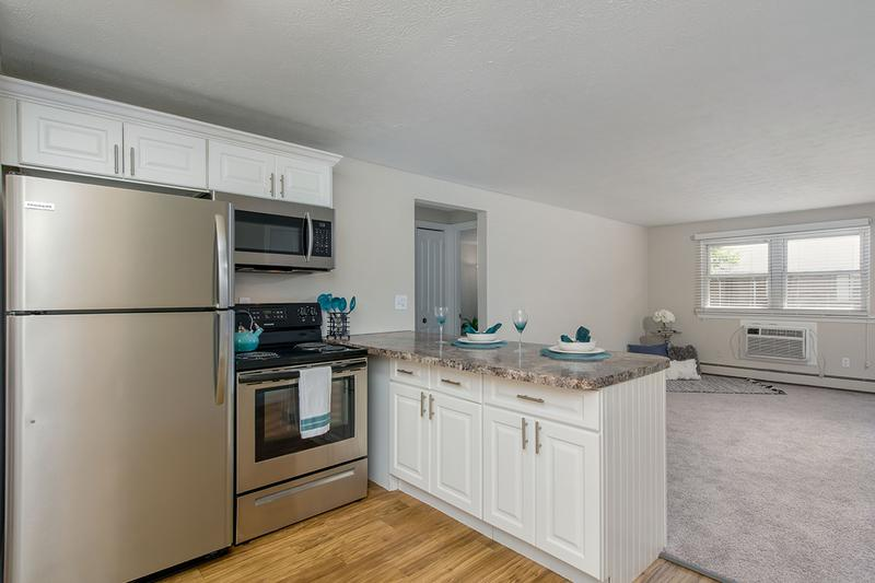 Updated Kitchen | Updated kitchens featuring wood-style flooring and stainless steel appliances.