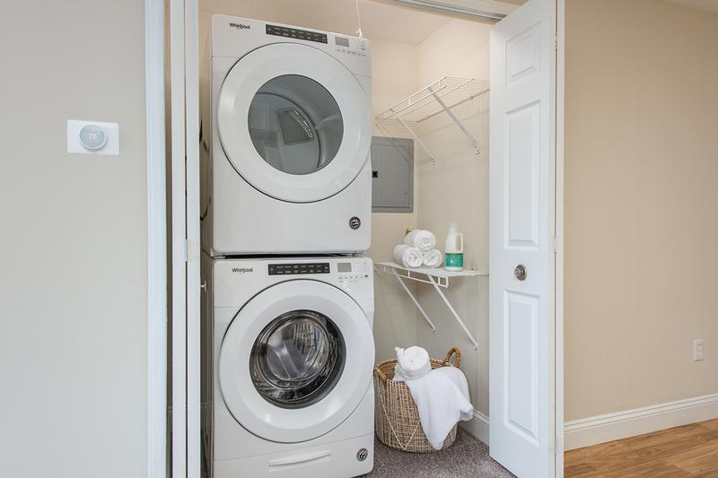 Laundry Room | Full size, stackable washer and dryer appliances are included in select apartment homes.