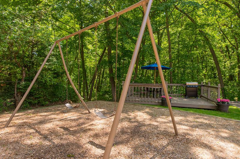 Swing Set | Our Chicopee community features a play area that is great for children.