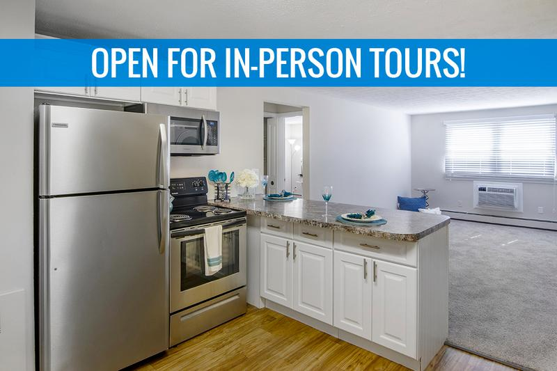 Updated Kitchen | Updated kitchens featuring wood-style flooring and stainless steel appliances. We are excited to offer in-person tours while following social distancing and we encourage all visitors to wear a face covering.