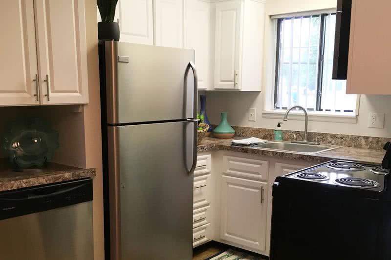 Updated Kitchen | Newly updated kitchens featuring a built-in pantry are and a dishwasher.