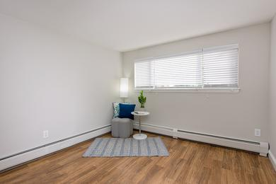 Bedroom | Spacious bedrooms featuring large windows and wood-style flooring.