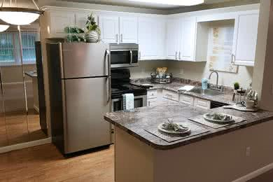 Fully Remodeled Kitchen | Fully remodeled kitchens featuring updated cabinetry, counter tops and stainless steel appliances.