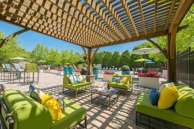 Expansive Sundeck | Relax on our expansive sundeck featuring cabanas, loungers, and tables and chairs.
