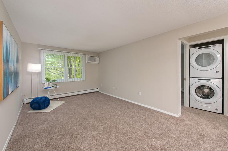 Living Room | Enjoy your bright, spacious living room featuring plush carpeting.