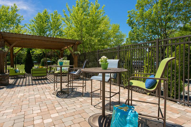 Poolside Tables | Our expansive sundeck features plenty of poolside tables and a gas grill.
