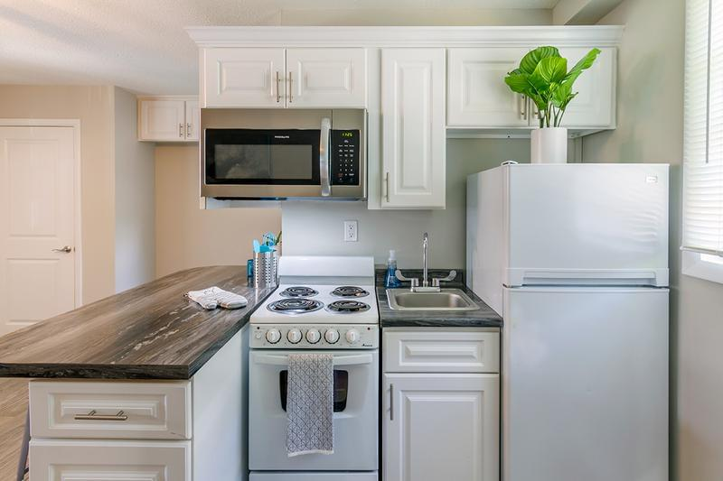 Remodeled Kitchen | Your new kitchen has plenty of cabinet space and a breakfast bar.