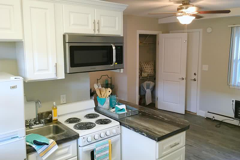 Kitchen | All of our kitchens come equipped with a refrigerator and stove with oven, along with great cabinet space.