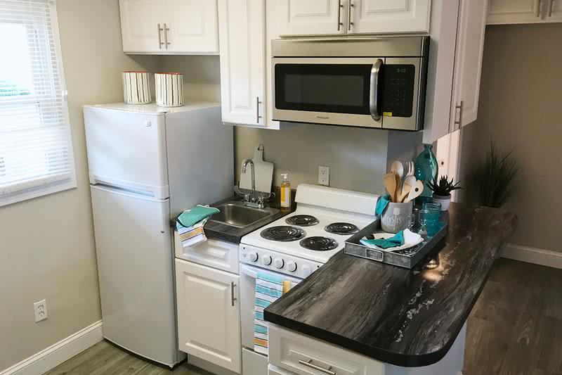 Remodeled Kitchen | Your new kitchen has plenty of cabinet space and a small breakfast bar.