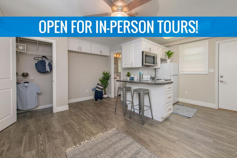 Living Area | Spacious, open living area with wood-style flooring and closets with organizers. We are excited to offer in-person tours while following social distancing and we encourage all visitors to wear a face covering.