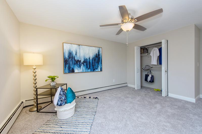Spacious Bedroom | Spacious bedrooms with plush carpeting and a ceiling fan.