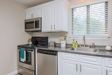Updated Kitchen | Large, open kitchens with stainless steel appliances in select apartments.