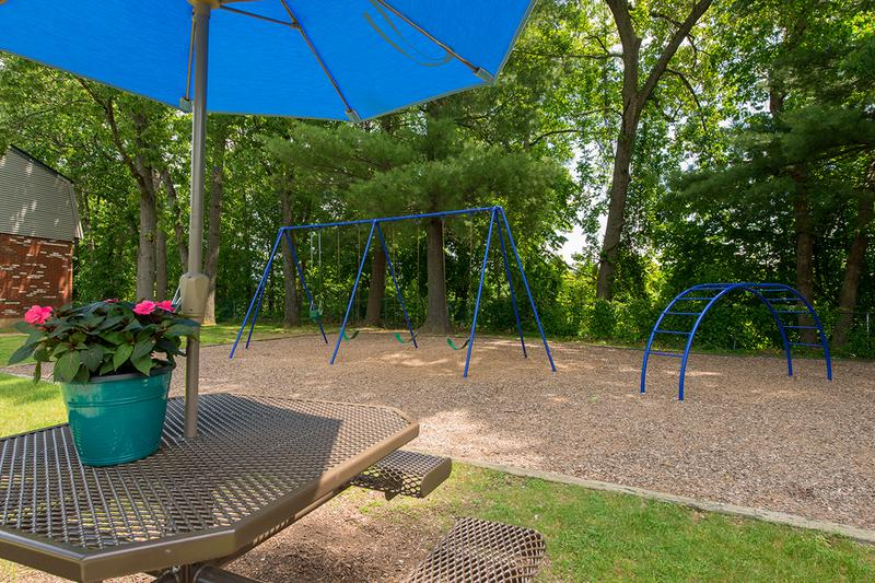 Picnic Tables | Sit under our shaded picnic tables while you watch the kids have fun on the playground.