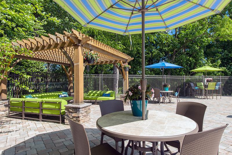 Poolside Cabanas and Tables | Our sundeck features plenty of poolside seating for you to enjoy.
