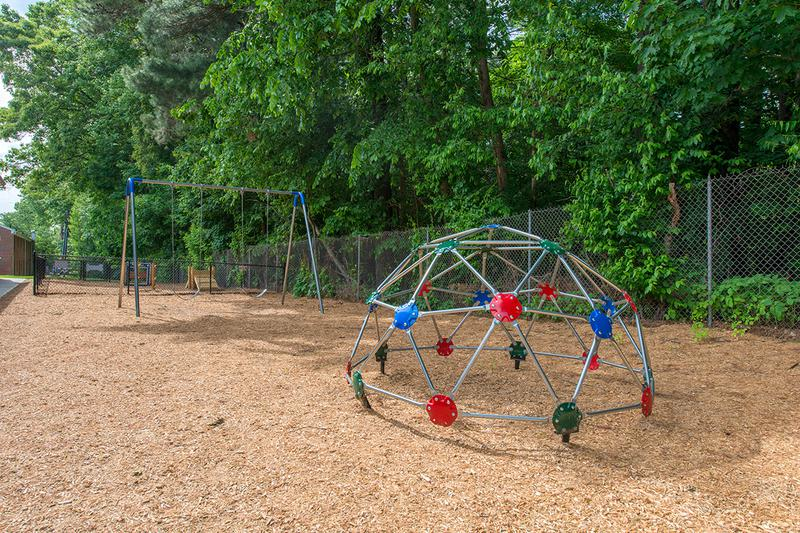 Playground | Our playground features a jungle gym, swing set and slide!