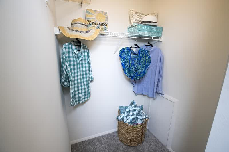 Walk-In Closet | Master bedrooms feature walk-in closets with built-in organizers.