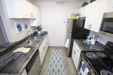 Fully Applianced Kitchen | Your fully applianced kitchen is complete with stainless steel appliances, including a dishwasher and offers an open floor plan concept overlooking the living area.