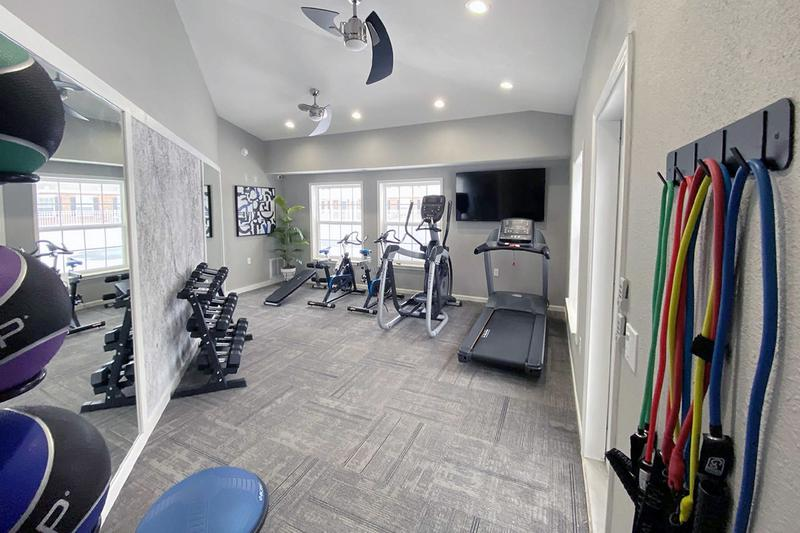 Fitness Center | Get fit in our brand new fitness center featuring all the cardio and weight training equipment you need for a full body workout.