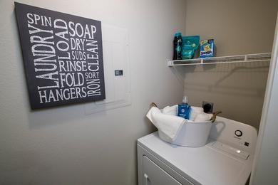 Laundry Room | Full size washer and dryer appliances included in all apartment homes.