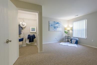 Master Bedroom | Master bedrooms featuring walk-in closets with built-in organizers and a master bathroom.