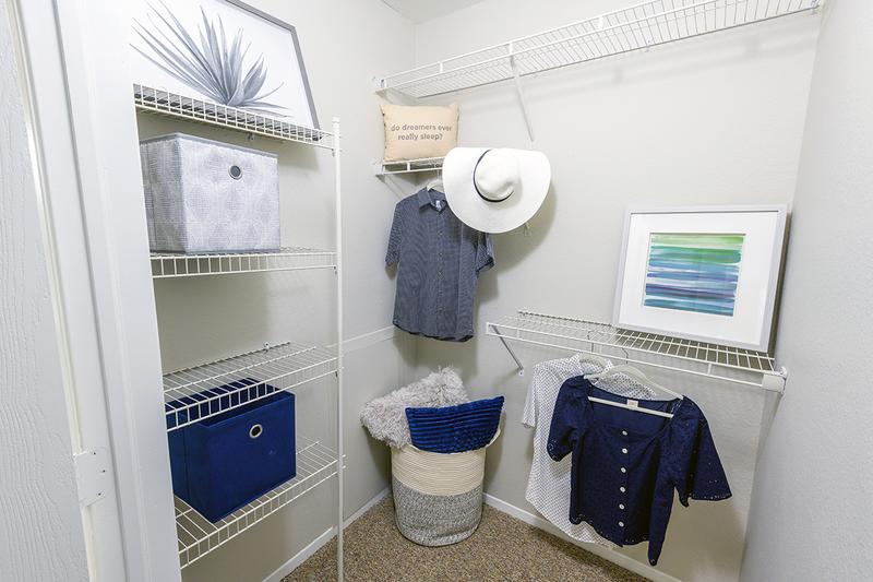 Walk-In Closet | Bedrooms feature walk-in closets with built-in organizers.