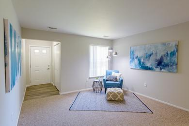 Living Room | Spacious, open living room that opens up to the kitchen and dining areas.