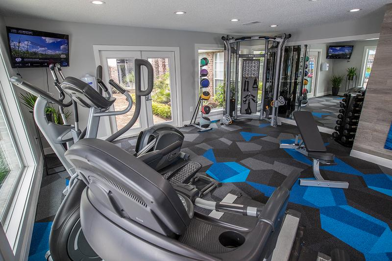 Fitness Center | Our brand new fitness center features all the weight training and cardio equipment you need for a full body workout.