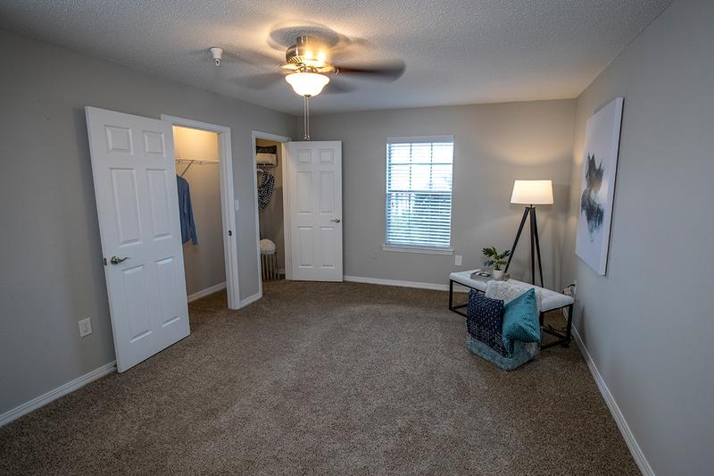 Bedroom | Spacious bedrooms featuring plush carpeting, a spacious closet, and a ceiling fan.