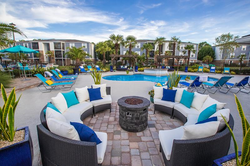 Poolside Firepit | Relax on our expansive sundeck by the poolside fire pit.