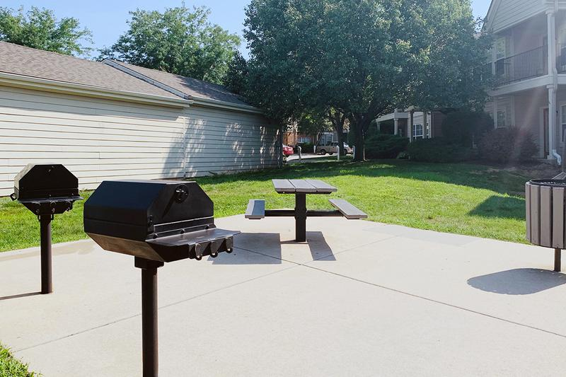 BBQ Grills | Have a cookout at our picnic area featuring charcoal grills and picnic tables.