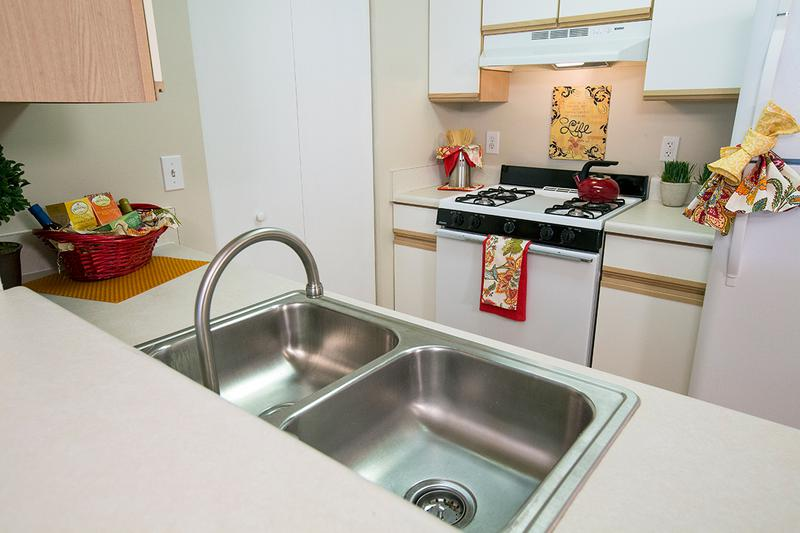 Fully Applianced Kitchen | Fully applianced kitchens featuring ample cabinet space and a breakfast bar.