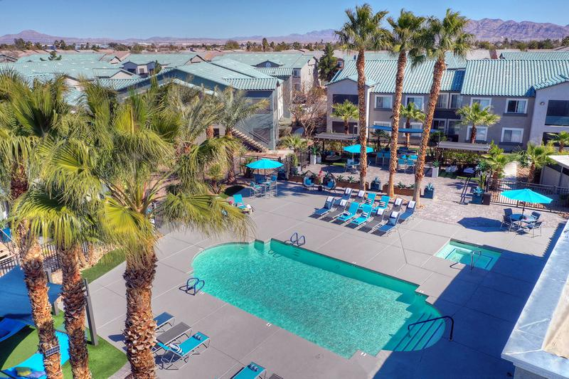 Aerial View of Pool | Our expansive resort-style pool and sundeck even features a spa and loungers.