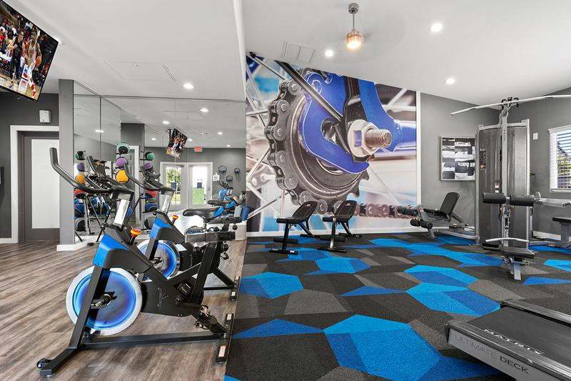 Spinning Bikes | Our fitness center also features spinning bikes .
