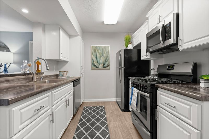 Stainless Steel Appliances | You'll definitely be the envy of friends and family-alike with this remodeled, chef-style kitchen!