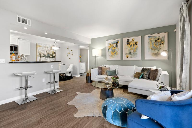Spacious Open Floor Plans | Entertain guests in this inviting and spacious living room with gorgeous natural, Las Vegas sunlight streaming through!