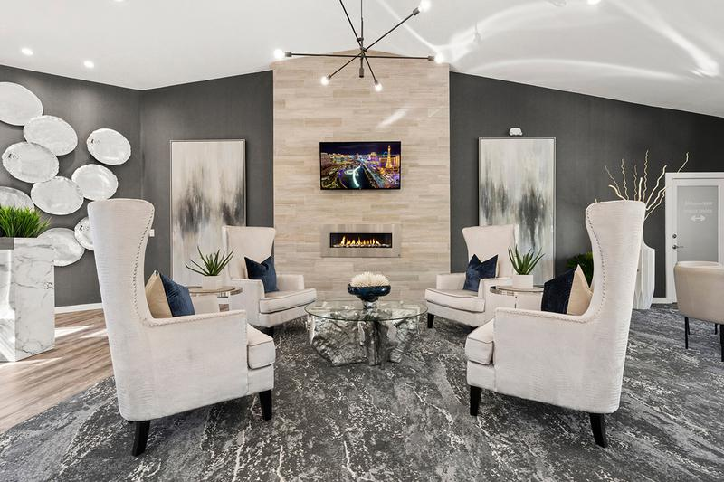 Seating Area | Have a seat and relax by the fire place in the leasing center.