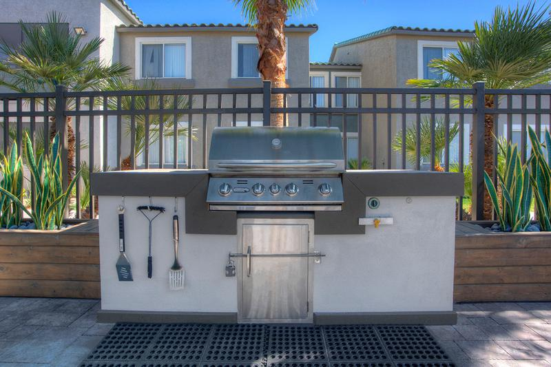 Gas Grill | Our outdoor kitchen features a gas grill so you can have a cookout by the pool.