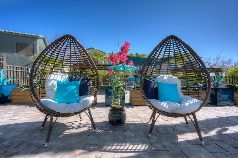 Pool Seating | Relax in comfortable seating while enjoying the beautiful views of the pool.