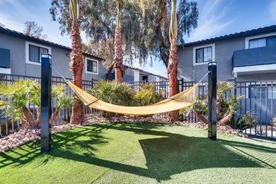 Hammocks | Lay out and soak in the sun from our poolside hammocks.