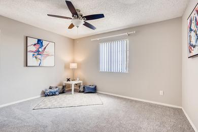 Master Bedroom | Master bedrooms featuring plush carpeting, a ceiling fan, and a walk-in closet.