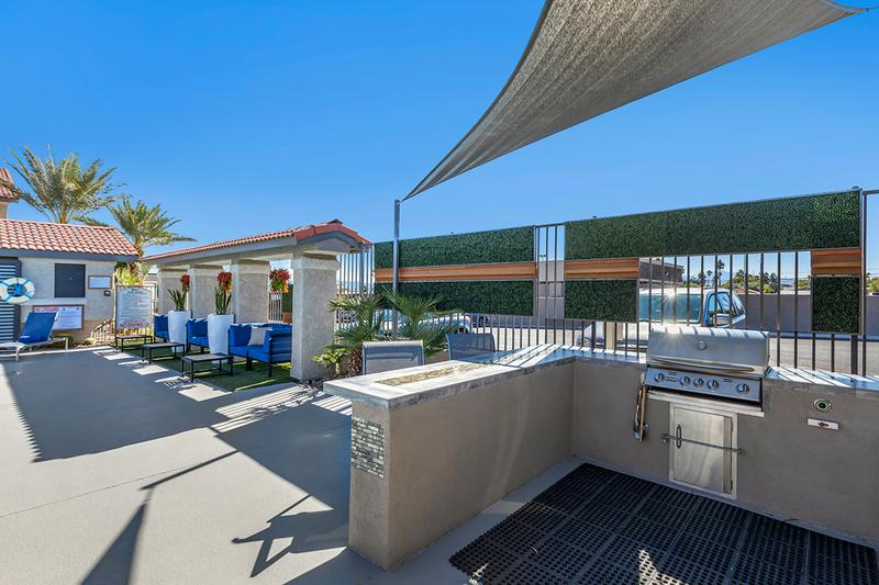 Outdoor Kitchen | Have a cookout poolside at our outdoor kitchen featuring a gas grill.