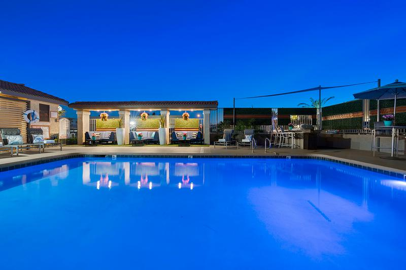 Poolside at Night | Enjoy beautiful views at night at our lit up pool area.