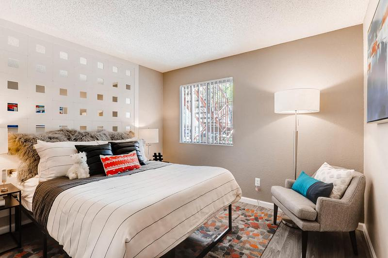 Bedroom | Spacious bedrooms featuring wood-style flooring and closets with built-in organizers.
