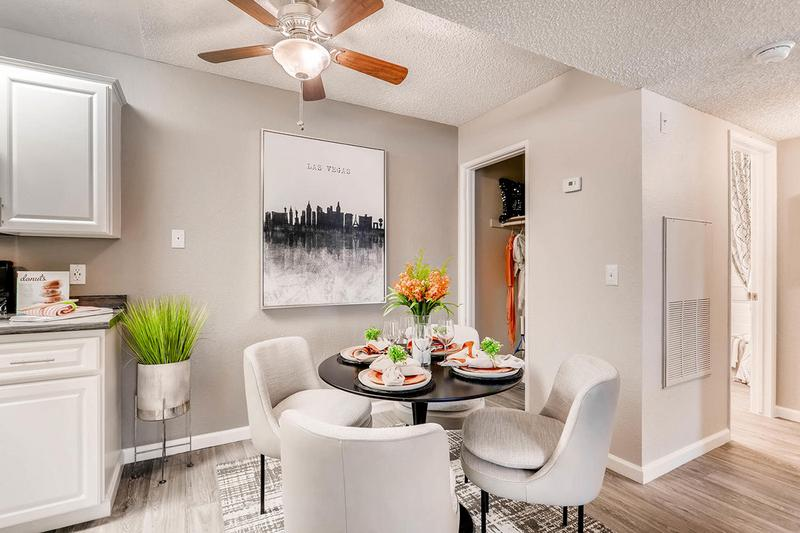 Separate Dining Room | Enjoy having a separate dining room with wood-style flooring located next to the kitchen.