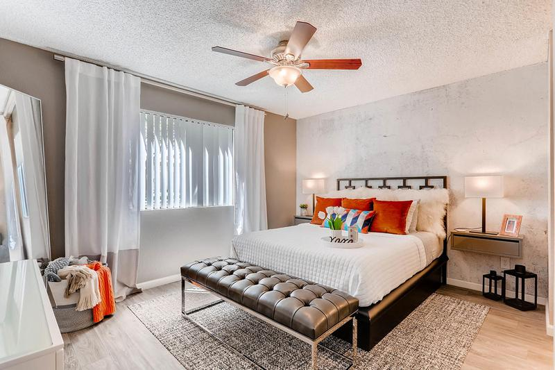 Master Bedroom | Master bedrooms featuring a ceiling fan, walk-in closet and private bathroom.