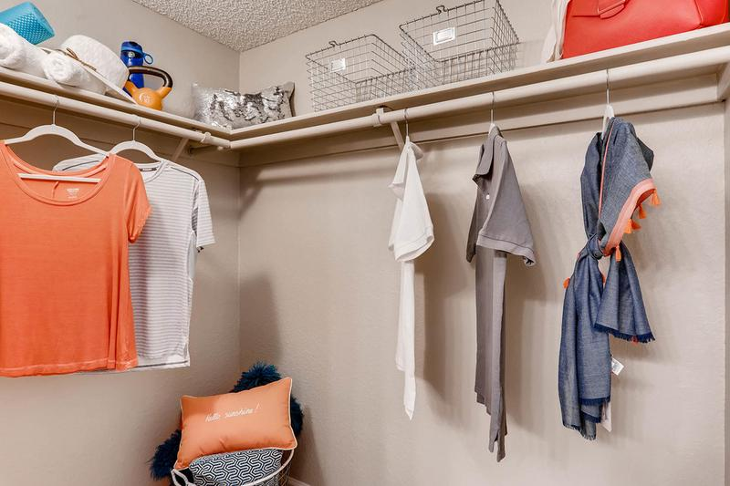 Walk-In Closet | Master bedrooms feature spacious walk-in closets with built-in organizers.