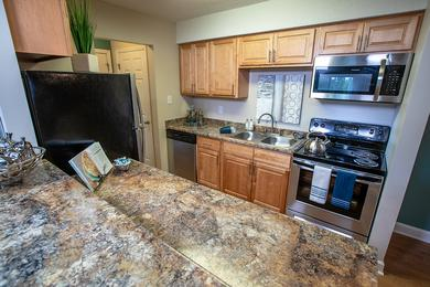 Kitchen with Breakfast Bar | Spacious kitchens featuring essential cabinet space and plentiful countertop space.